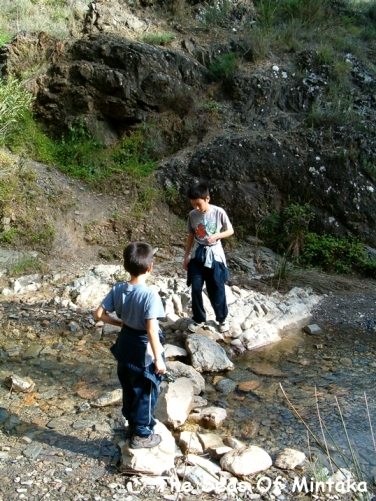 Kids Playing in a Stream Malaga Spain